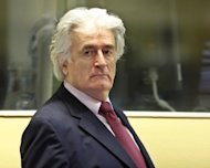 Bosnian Serb wartime leader Radovan Karadzic, seen here in 2009, has demanded a new genocide trial before the Yugoslav war crimes court, saying prosecutors were late in disclosing evidence favourable to his case