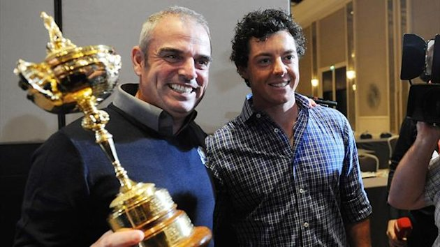 Paul McGinley of Ireland (L) poses with the Ryder Cup while flanked by Rory McIlory of Northern Ireland during a news conference after McGinley was named the European Ryder Cup captain at the St. Regis in Saadiyat Islands in Abu Dhabi (Reuters)