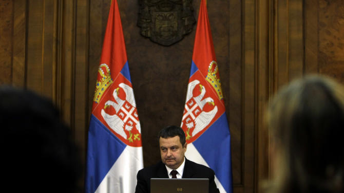 Ivica Dacic, the Serbian Prime Minister, center, presides over a session of the Serbian government in Belgrade, Serbia, Monday, April 22, 2013. The Serbian government on Monday approved a potentially landmark agreement to normalize relations with breakaway Kosovo that could end years of tensions and put the Balkan rivals on a path to European Union membership. (AP Photo/ Marko Drobnjakovic)