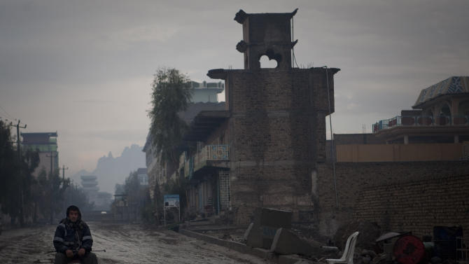 In this Feb. 13, 2011 picture, a private security guard watches a sensitive neighborhood in Kandahar, Afghanistan. Many in this impoverished city still feel insecure even after 10 years of NATO presence in the capital of the province that was the birthplace of the Taliban. (AP Photo/Anja Niedringhaus)