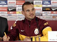 Dutch playmaker Wesley Sneijder poses for media during a signing ceremony in Istanbul January 22, 2013. REUTERS/Osman Orsal/Files