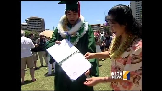 Wounded warrior athlete shares in son's graduation