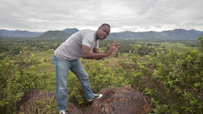 In this March 31, 2015 photo, Williamcite Noel, 37, onsite manager of VCS Mining Inc. shows an area to be explored for minerals and metals at the Morne Bossa mine site in Cap Haitien, Haiti. For now Noel is the only VCS employee in Haiti. Although VCS received one of two gold mining permits in December 2012, the project known by the hill on which is located, Morne Bossa, was paralyzed two months later when Parliament imposed a moratorium on mining activity in Haiti amid deep concerns about whether the country has the capacity to adequately regulate such a complex industry. (AP Photo/Dieu Nalio Chery)