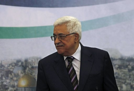 Palestinian President Abbas arrives to a meeting with members of the media in Ramallah