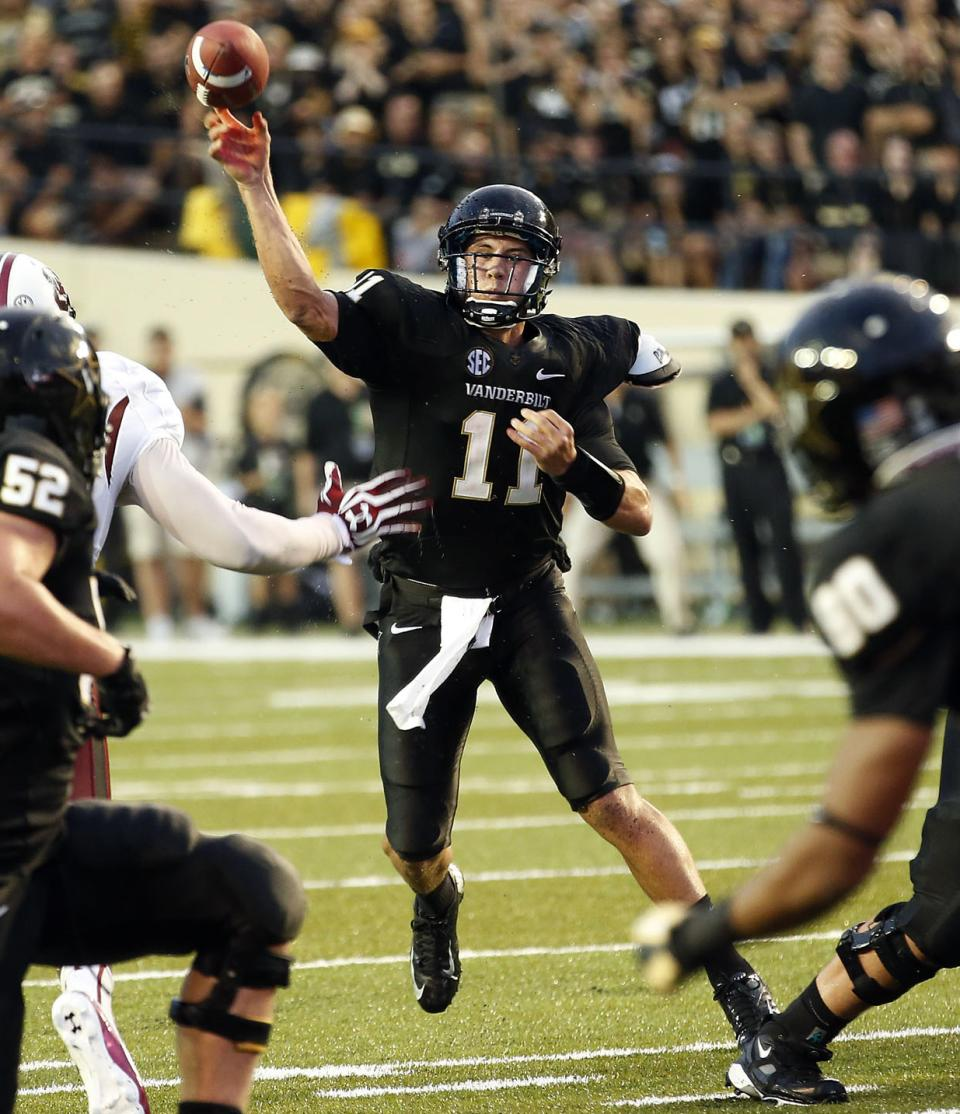 Vanderbilt quarterback Jordan Rodgers (11) throws to receiver Chris Boyd (80) in the second half of an NCAA college football game against South Carolina, Thursday, Aug. 30, 2012, in Nashville, Tenn. South Carolina won 17-13. (AP Photo/John Russell)