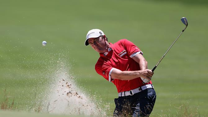 Jimmy Walker hits out of a bunker on the first hole during the second round of the Greenbrier Classic at the Old White TPC on July 4, 2014 in White Sulphur Springs, West Virginia
