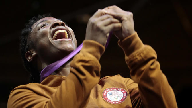 Gold medalist Claressa Shields of the United participates in the medals ceremony after their women's final middleweight 75-kg gold medal boxing match at the 2012 Summer Olympics, Thursday, Aug. 9, 2012, in London. (AP Photo/Ivan Sekretarev)