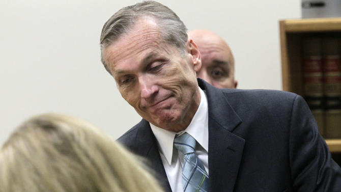 Martin MacNeill enters Judge Derek Pullan's 4th District Court for his trial in Provo, Utah, Thursday, Oct. 17, 2013. MacNeill, a former doctor, is charged with murder in the 2007 death of his wife. MacNeill, 57, was charged in August 2012, nearly five years after his former beauty queen wife, Michele MacNeill, was found in the bathtub at the couple's Pleasant Grove home, about 35 miles south of Salt Lake City. (AP Photo/The Salt Lake Tribune, Al Hartmann, Pool)