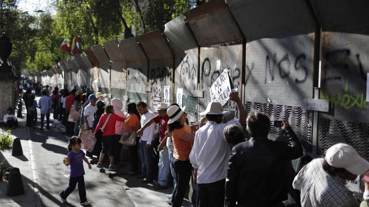 Demonstrators hit a fence during a protest against the energy reform bill outside the Senate building in Mexico City