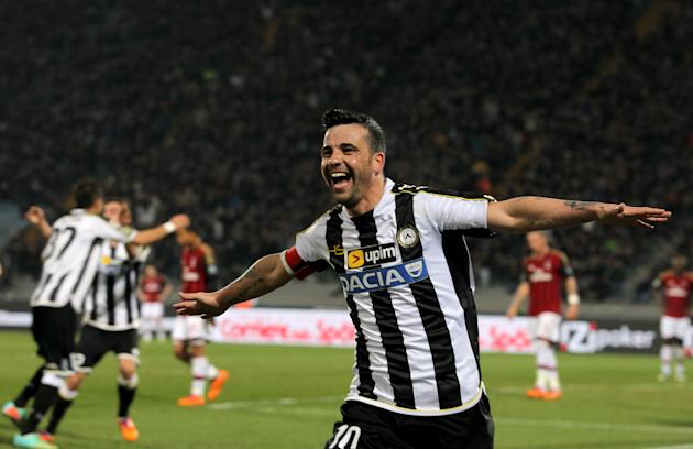 Udinese's Antonio Di Natale, celebrate after scoring during the Serie A soccer match between Udinese and AC Milan at the Friuli Stadium in Udine, Italy, Saturday, March 8, 2014