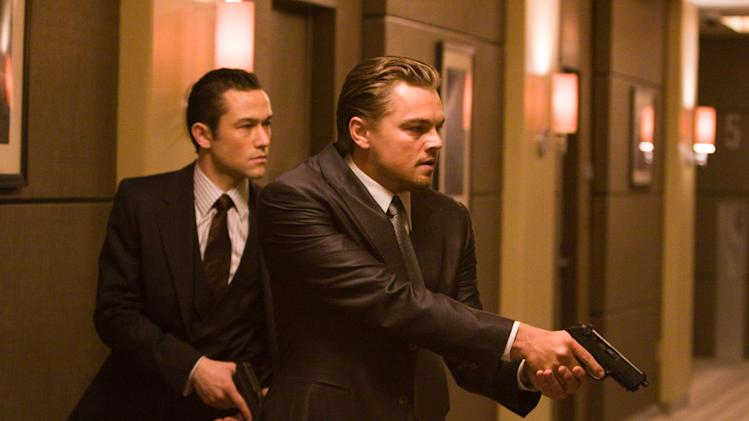 """In this film publicity image released by Warner Bros., Joseph Gordon Levitt, left, and Leonardo DiCaprio are shown in a scene from """"Inception."""" Gun violence in PG-13 rated movies has increased considerably in recent decades, to the point that it sometimes exceeds gun violence in even R-rated films, according to a study released Monday. Ohio State University and the Annenberg Public Policy Center at the University of Pennsylvania surveyed gun violence in top-grossing movies, finding that it had more than tripled in PG-13 films since 1985. (AP Photo/Warner Bros., Stephen Vaughan)"""