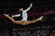 US gymnast Gabrielle Douglas performs during the women&#39; s beam final of the artistic gymnastics event of the London Olympic Games, on August 7, at the 02 North Greenwich Arena