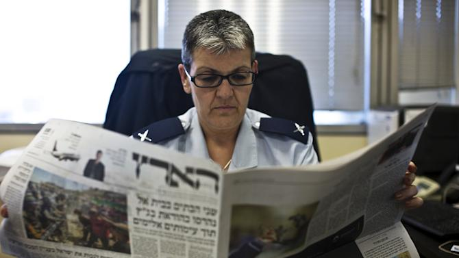 Sima Vaknin-Gill, Israel chief military censor, reads a local Israeli newspaper in her office in Tel Aviv