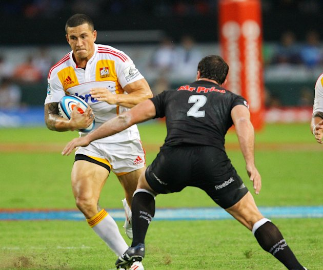 New Zealand Waikato Chiefs' Sonny Bill Williams (L) tries to avoid the tackled of Durban Sharks' Bismarck du Plessis during a Super 15 rugby union match at the Mr Price Kings Park Rugby Stadium on Apr