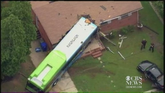 Bus crashes into Md. home