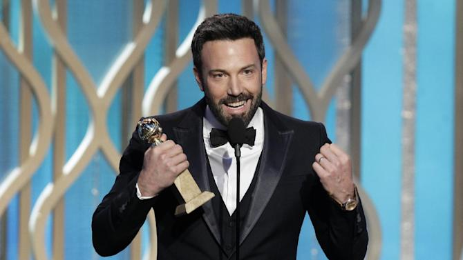 """This image released by NBC shows Ben Affleck with his award for best director for """"Argo"""" during the 70th Annual Golden Globe Awards at the Beverly Hilton Hotel on Jan. 13, 2013, in Beverly Hills, Calif. (AP Photo/NBC, Paul Drinkwater)"""