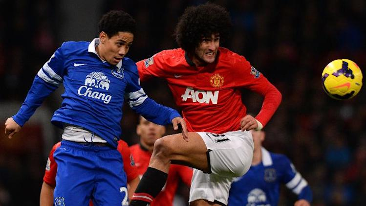 Marouane Fellaini (right) challenges Everton's Steven Pienaar in a Premier League game at Old trafford on December 4, 2013