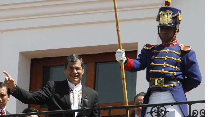 "**CORRECTS DIRECTION OF PRESIDENT ** Ecuador's President Rafael Correa, left, greets passersby from the balcony of the presidential palace during the weekly, The Change of the Guard, in Quito, Ecuador, Monday, June 24, 2013. The Ecuadorian government declared Monday that national sovereignty and universal principles of human rights would govern their decision on granting asylum to Edward Snowden, powerful hints that the former National Security Agency contractor is welcome despite potential repercussions from Washington. Correa said on Twitter that ""we will take the decision that we feel most suitable, with absolute sovereignty."" AP Photo/Dolores Ochoa)"