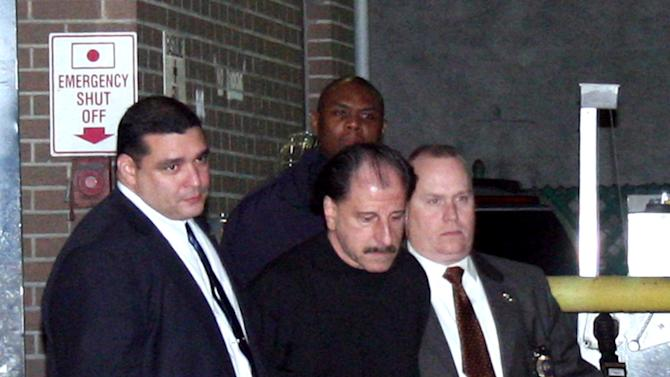 In this Nov. 21, 2012 photo provided by VosIzNeias.com, police escort Salvatore Perrone, center, from New York's the 67th Precinct. Perrone, a New York City garment salesman accused of systematically shooting three Middle Eastern shopkeepers to death, was taken into custody Wednesday in the suspected serial killings. A pharmacy worker recognized Perrone, 63, as the balding man shown in surveillance footage leaving the scene of the most recent shooting on Nov. 16, police said. (AP Photo/VosIzNeias.com, Shimon Gifter)