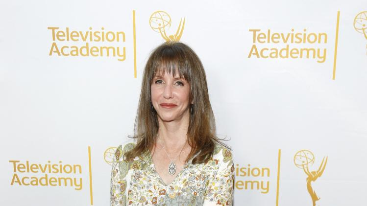Newman poses at the Television Academy's Performers Peer Group cocktail reception to celebrate the 66th Primetime Emmy Awards in Beverly Hills