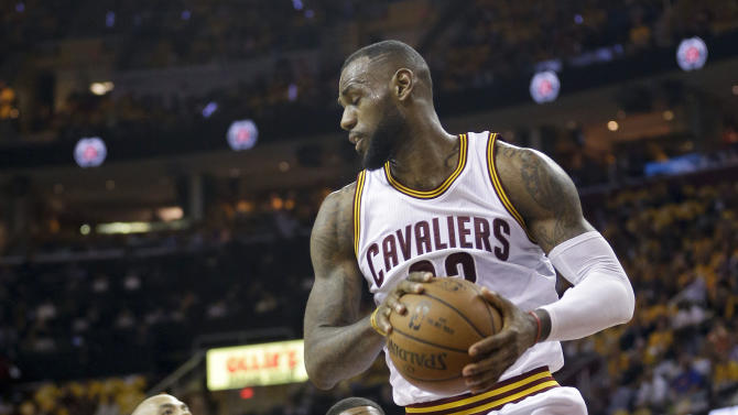Cleveland Cavaliers forward LeBron James (23) grabs a rebound against the Chicago Bulls during the first half of Game 1 in a second-round NBA basketball playoff series Monday, May 4, 2015, in Cleveland. (AP Photo/Tony Dejak)