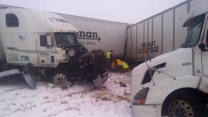 This photo provided by the Iowa State Patrol shows the scene of a 25-vehicle pileup that killed two people and injured several others Thursday, Dec. 20, 2012 on Interstate 35 about 60 miles north of Des Moines, Iowa. Authorities say poor visibility caused the accident when drivers were unable to see vehicles that had slowed or stopped, causing a chain reaction of crashes. (AP Photo/Iowa State Patrol)