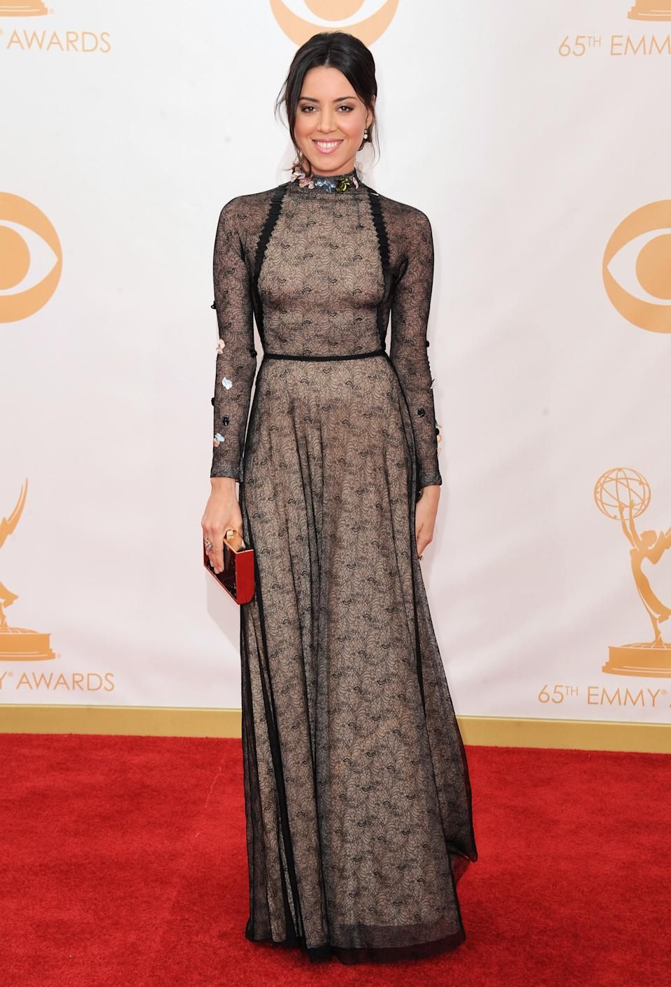 Aubrey Plaza, wearing Marios Schwab, arrives at the 65th Primetime Emmy Awards at Nokia Theatre on Sunday, Sept. 22, 2013, in Los Angeles. (Photo by Jordan Strauss/Invision/AP)