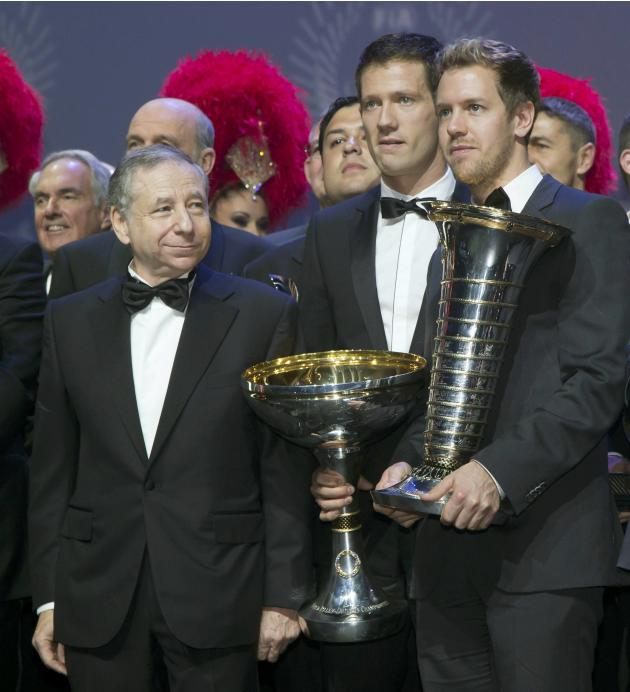 From L-R, FIA President Todt, 2013 Rally World Champion Ogier of France and 2013 Formula One World Champion Vettel of Germany pose during the 2013 FIA Prize Giving gala in Saint-Denis
