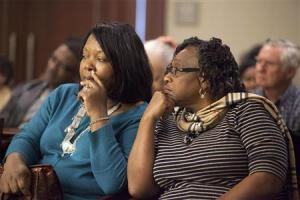 Stinney family relatives listen during testimony in the case of George Stinney Jr., in Sumter