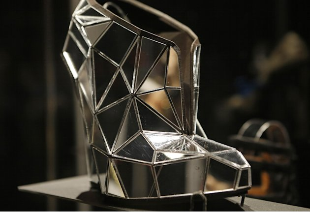 This Feb. 11, 2013 photo shows a shoe, made of mirror fragments titled &quot;Invisible&quot;, designed by Andreia Chaves, displayed at the &quot;Shoe Obsession&quot; exhibit at The Museum at the Fashion Institute of Tech