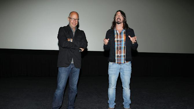 EXCLUSIVE - Director Peter Chelsom and musical contributor Dave Grohl of the Foo Fighters introduced a showing of Relativity's 'Hector and the Search for Happiness' at ArcLight Hollywood on Saturday, September 20, 2014 in Hollywood, CA(Photo by Eric Charbonneau/Invision for Relativity Media/AP Images)