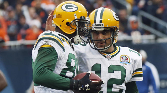 Green Bay Packers quarterback Aaron Rodgers, right, celebrates the touchdown reception by wide receiver James Jones (89) in the first half of an NFL football game against the Chicago Bears in Chicago, Sunday, Dec. 16, 2012. (AP Photo/Charles Rex Arbogast)