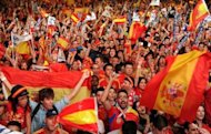 Supporters of Spain's national football team celebrate on July 1 in Madrid after their team defeated Italy 4-0 in the Euro 2012 football championships final in Kiev. A red-and-yellow sea of delirious fans swamped central Madrid in a wild all-night party before hailing the return on Monday of their conquering Euro 2012 heroes