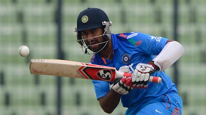 Indian batsman Cheteshwar Pujara plays a shot during the third and final One Day International (ODI) match between India and Bangladesh at the Sher-e-Bangla National Cricket Stadium in Dhaka on June 19, 2014