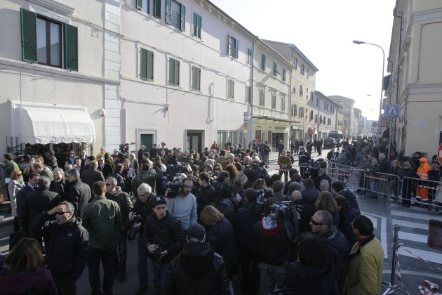 People gather outside the Moderno theater in Grosseto, Italy, Saturday, March 3, 2012 for the Costa Concordia shipwreck initial evidence hearing. The Italian prosecutor for the investigation of the Co