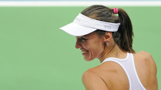 Switzerland's Martina Hingis smiles after her game against Poland's Agnieszka Radwanska during their Fed Cup World Group Playoff tennis match between Poland and Switzerland, in Zielona Gora, Poland, Saturday, April 18, 2015.   Five-time Grand Slam champion Martina Hingis  played  her first competitive singles match since 2007. (AP Photo/Alik Keplicz)