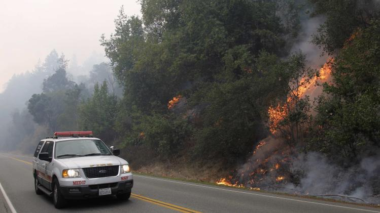 A wildfire burns next to Highway 1 in Big Sur, California