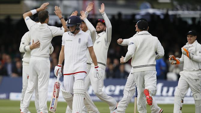 England's Gary Balance leaves the pitch after he is bowled for 0 by New Zealand's Tim Southee during the third day of the first Test match between England and New Zealand at Lord's cricket ground in London, Saturday, May 23, 2015. (AP Photo/Kirsty Wigglesworth)