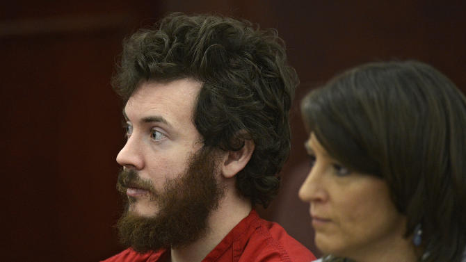 FILE - In this March 12, 2013 file photo, James Holmes, left, and defense attorney Tamara Brady appear in district court in Centennial, Colo. for his arraignment. Lawyers for Holmes, the man accused of killing 12 people and injuring 70 in a Colorado movie theater, said Tuesday May 7, 2013 he wants to change his plea to not guilty by reason of insanity. (AP Photo/The Denver Post, RJ Sangosti, Pool, File)