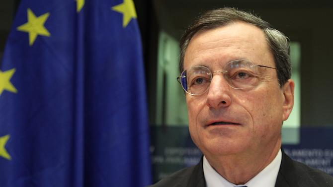 President of the European Central Bank Mario Draghi addresses the Committee on Economic and Monetary Affairs, at the European Parliament building, in Brussels on Monday, Dec. 17, 2012. (AP Photo/Yves Logghe)