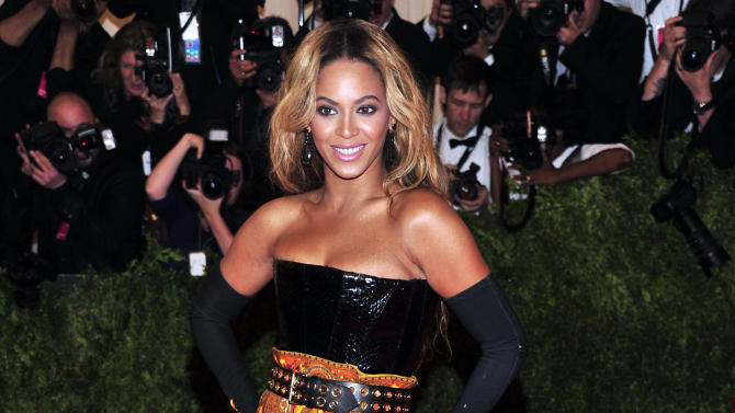 """Beyonce attends The Metropolitan Museum of Art's Costume Institute benefit celebrating """"PUNK: Chaos to Couture"""" on Monday May 6, 2013 in New York. (Photo by Charles Sykes/Invision/AP)"""