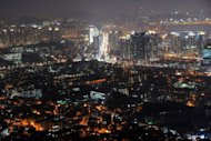A night view of Seoul is seen from the N Seoul Tower in 2010. South Korea&#39;s state-run think tank Sunday cut the nation&#39;s growth forecast for this year to 3.6 percent from 3.8 percent estimated in November, citing weakening demand amid a global slowdown