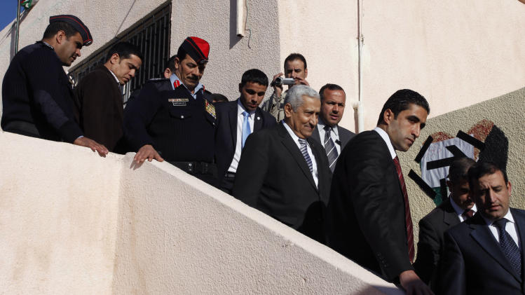 Jordanian prime minister Abdullah Ensour, third from right, arrives at the polling station to cast his vote, during the first hours of the Jordanian Parliamentary elections, in Al-Salt, Jordan, Wednesday Jan. 23, 2013. (AP Photo/Mohammad Hannon)