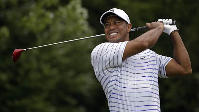 In this Friday, Aug. 8, 2014 file photo, Tiger Woods winces after tee shot on the sixth hole during the second round of the PGA Championship golf tournament at Valhalla Golf Club in Louisville, Ky. Tiger Woods removed himself from consideration for the Ryder Cup team Wednesday evening, Aug. 13, 2014 with a clear message that he is not healthy enough to play