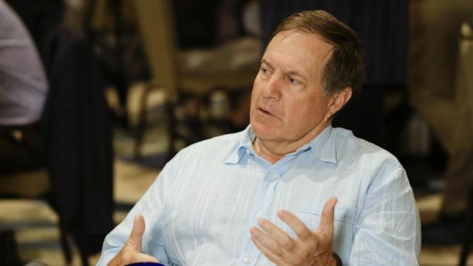 New England Patriots head coach Bill Belichick answers reporters questions during the AFC head coaches breakfast at the NFL football annual meeting in Orlando, Fla., Tuesday, March 25, 2014