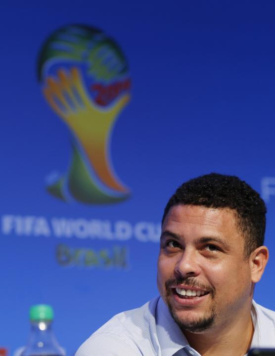Former Brazilian soccer player Ronaldo attends a news conference ahead of the 2014 World Cup draw in Sao Joao da Mata