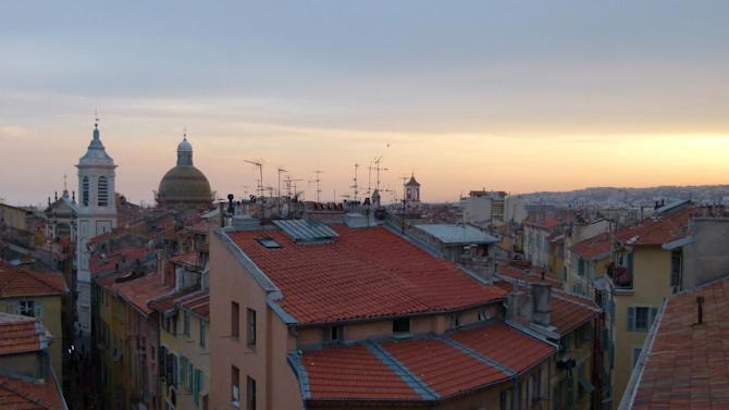 "This photo taken May 2011 shows the rooftops of Old Nice at sunset in Nice, France. The picturesque setting of the Riviera has been the backdrop for a number of movies including ""To Catch a Thief"" starring Cary Grant and Grace Kelly. The city of Nice attracts tourists year-round thanks to the flower markets, restaurants, historic sites and events ranging from Mardi Gras to the annual film festival in Cannes. (AP Photos/Michelle Locke)"