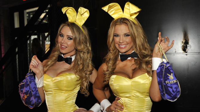 IMAGE DISTRIBUTED FOR CROWN ROYAL - Playboy Playmates Tiffany Toth, left and and Jessa Hinton stuff  Crown Royal camo care packages for U.S. troops overseas during the Playboy Party presented by Crown Royal, Friday, Feb. 1, 2013, in New Orleans. The packages will be shipped as part of the Crown Royal Heros Project honoring American soldiers. (Photo by Jack Dempsey/Invision for Crown Royal/AP Images)