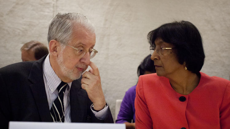 "Brazilian diplomat Paulo Sergio Pinheiro, left, taks to  UN High Commissioner for Human Rights Navi Pillay before delivering the report of the Independent Commission of Inquiry on Syria during to the Human Rights Council at the United Nations in Geneva, Switzerland, Monday, Sept. 17, 2012.  An increasing number of ""foreign elements"" including jihadis are now operating in Syria, an independent U.N. panel confirmed Monday in its first report to say that outside ""terrorists"" have joined a war spiraling out of control. (AP Photo/Anja Niedringhaus)"