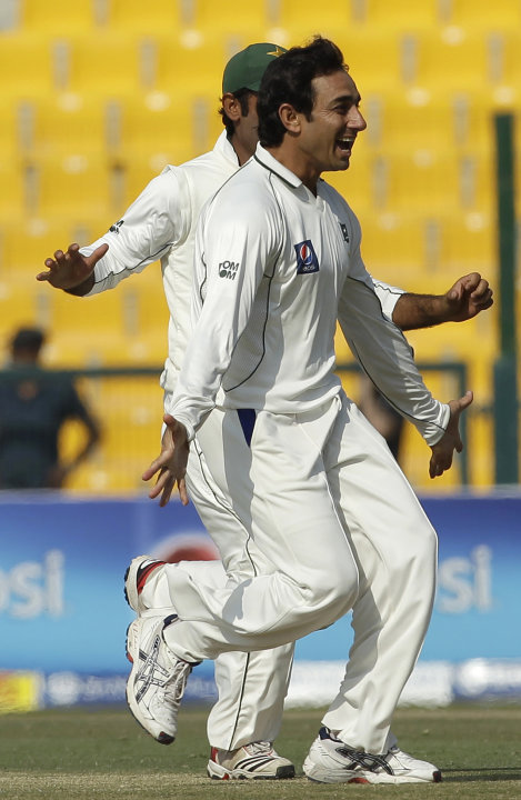 Pakistan's Saeed Ajmal celebrates with his teammates taking the wicket of England's Ian Bell during the fourth day of the second cricket Test match of a three match series between England and Pakistan
